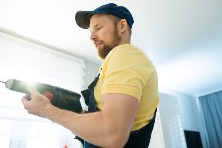Busy handyman using power drill